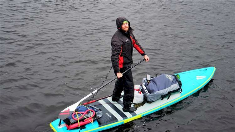 Extreme paddle boarder completes gruelling 24hour journey